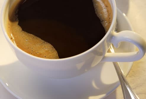 Cup of black coffee, close-up