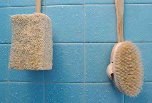 brushes on wet wall in bathroom