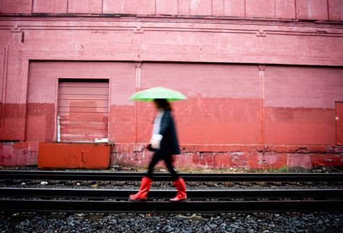 Woman With Red Boots and Green Umbrella