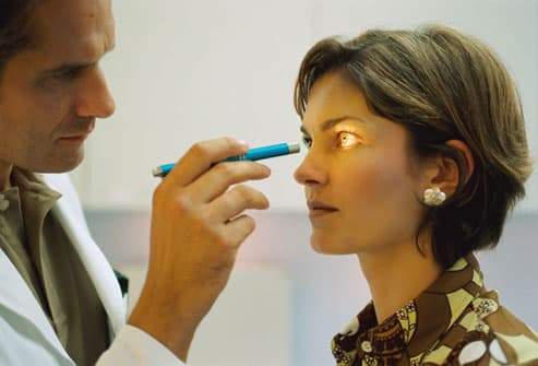 Doctor Giving Woman Eye Exam