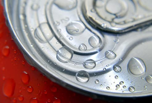 cold soft drink can with water drops