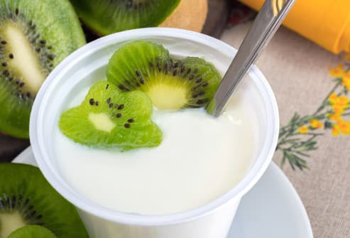 yogurt cup and kiwi fruit