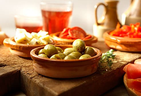small plates of olives and cheese