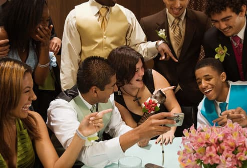 teens laughing at prom