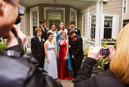 teens posing in prom garb