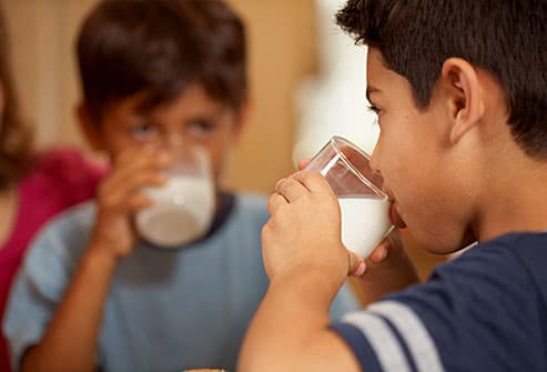 Boys drinking milk