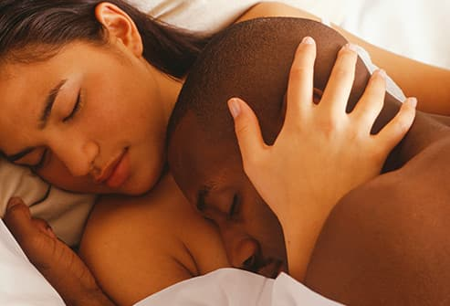 couple sleeping in bed close up