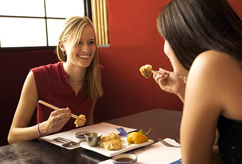two young women having meal
