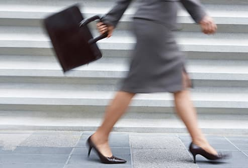 businesswoman walking briskly