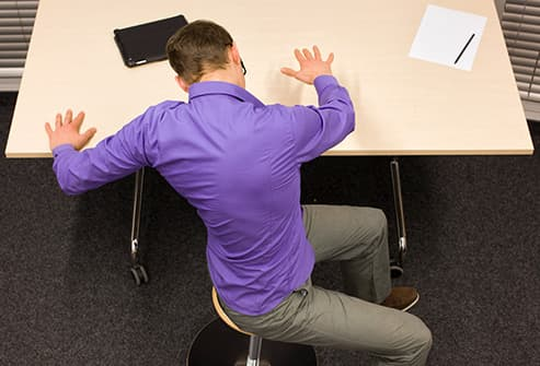 man doing exercise at desk
