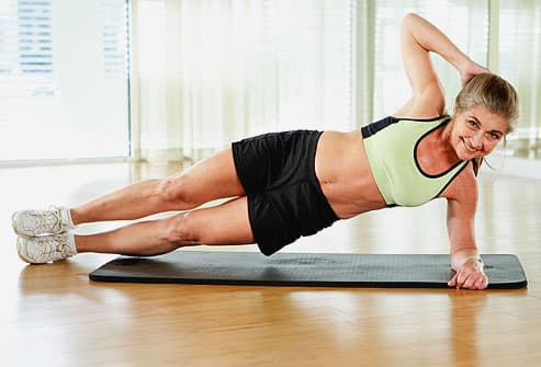 Trainer showing proper alignment for side plank