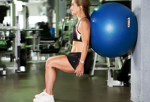 Beginner squat with exercise ball