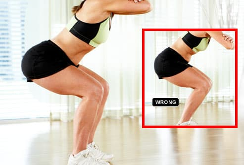 Using good form while doing squats