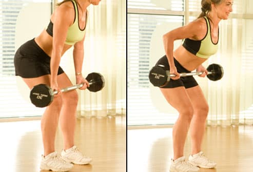 Trainer performing bent-over row with barbells