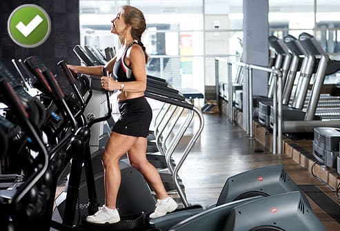 Woman working out on an elliptical machine