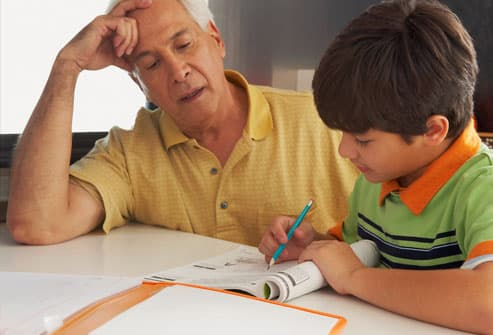 man helping his boy do his homework