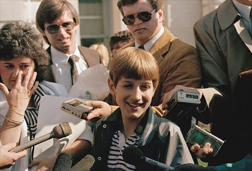 AIDS victim Ryan White surrounded by reporters