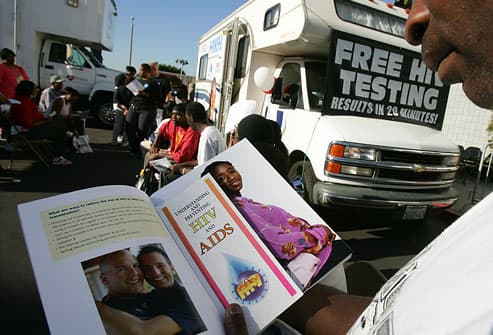 LA man reads brochure as he waits for HIV test