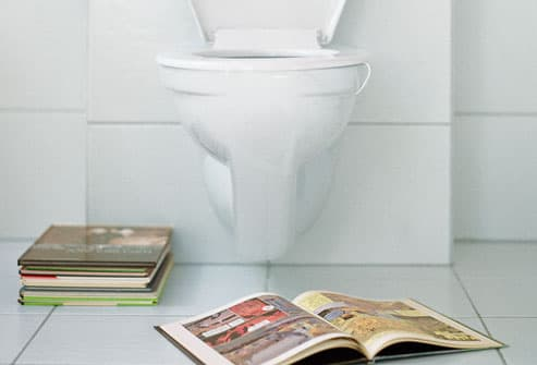 Open Book in Front of Toilet
