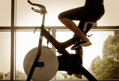 Woman Riding Exercise Bike