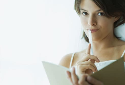 Woman With Pen and Diary