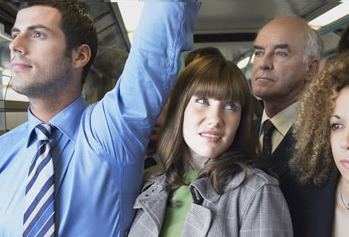 Woman on Crowded Commuter Train