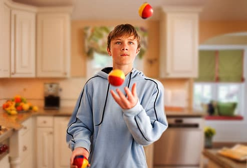 Teen boy juggling
