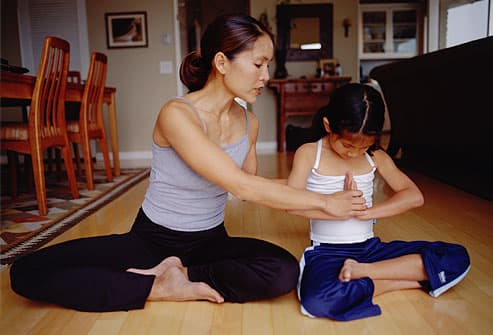Mother and daughter practicing yoga