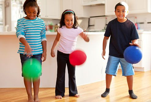 Kids playing bouncing ball in kitchen