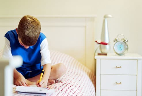 Boy in room with pressed wood furniture