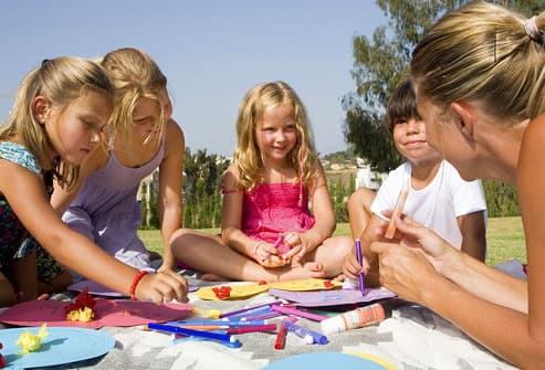 Kids doing crafts outdoors