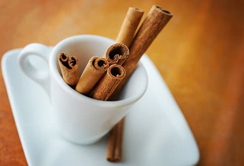 cinnamon sticks in coffee cup