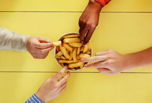 friends sharing french fries