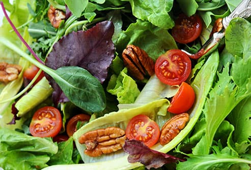 salad topped with pecans