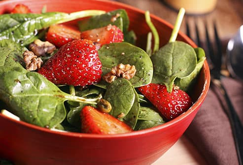 salad topped with berries