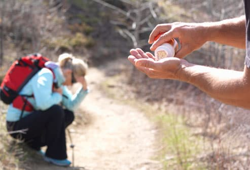 Mature hiking couple in need of pain pills