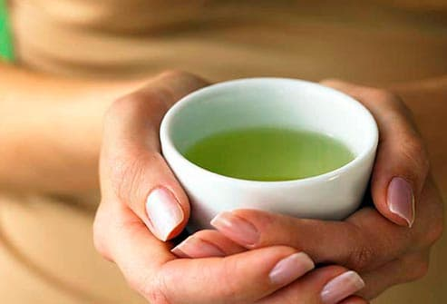 woman holding green tea