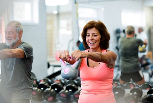 mature woman lifting kettlebell