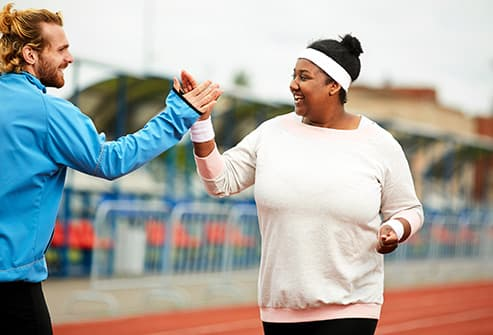 woman highfiving her trainer