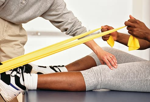 man working out with resistance band