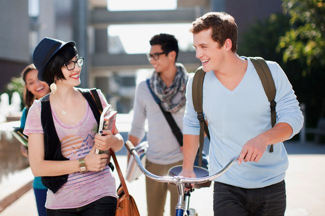 photo of group of young people walking