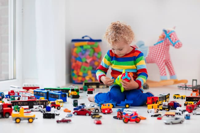 photo of child playing with toys
