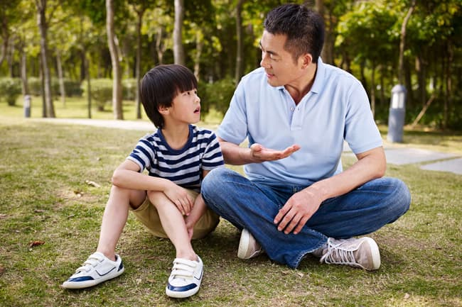 photo of dad talking with son