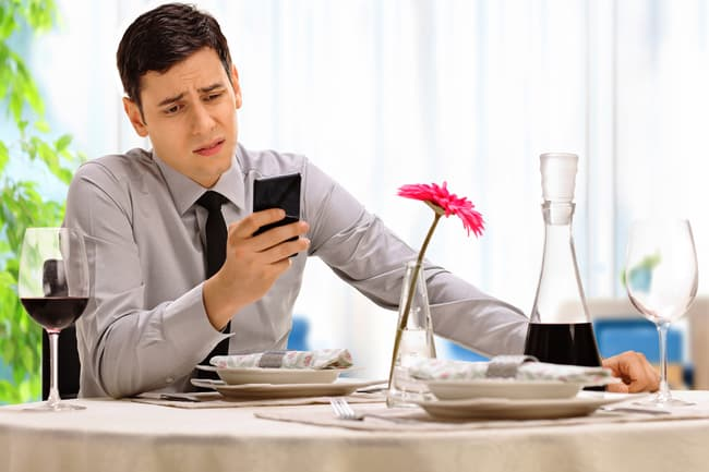 man looking at phone concerned