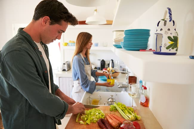 couple cooking and cleaning