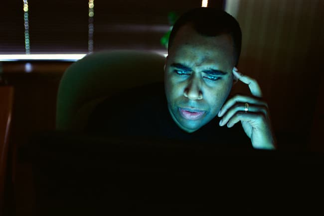 man staring at compute screen