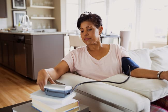 mature woman checking blood pressure