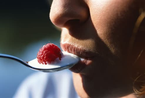 Woman Eating Probiotic Yogurt