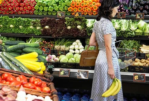 woman shopping in produce aisle