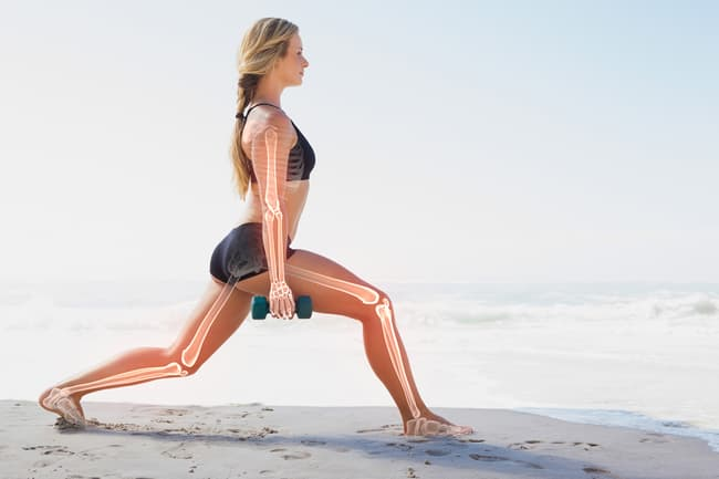 photo of woman working out on beach